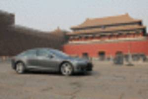 tesla confirms plans to build cars in china